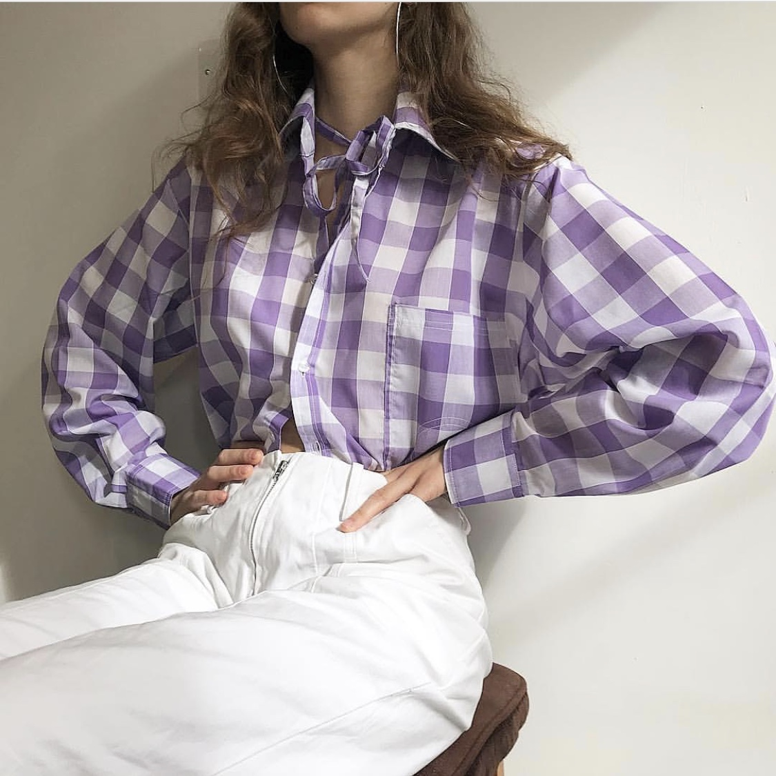 woman wearing violet plaid shirt and white jeans