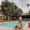 woman sitting in the poolside for places in LA to relax