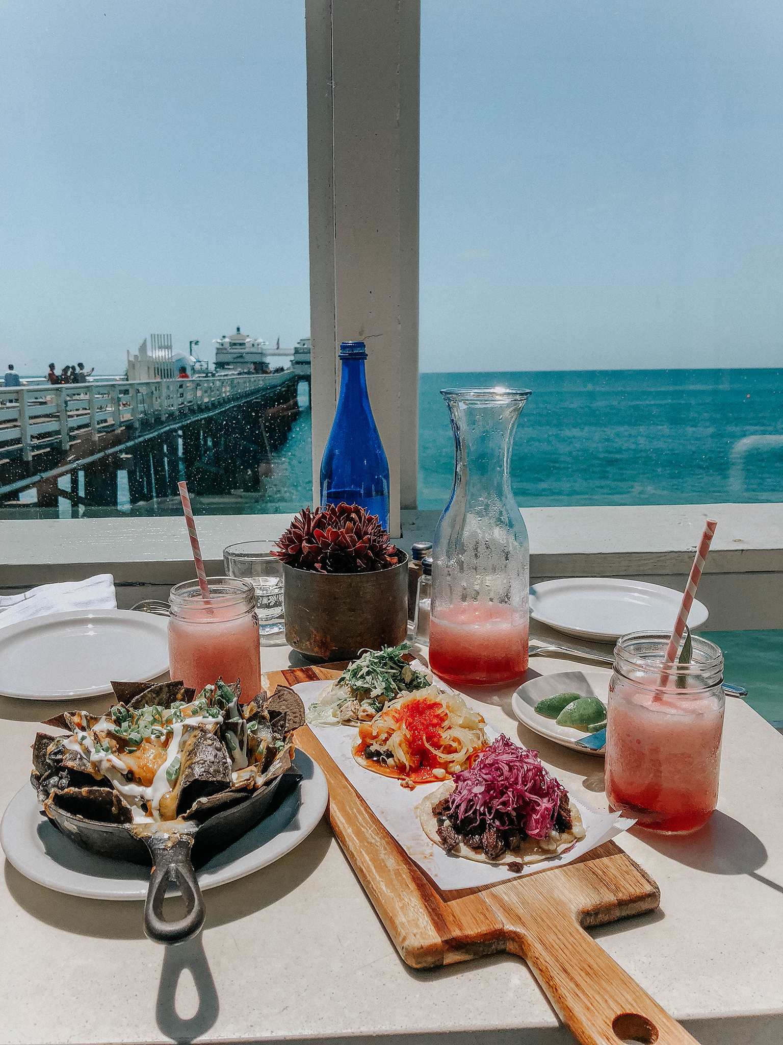 food on the table with the view of the ocean for perfect day in malibu